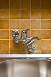 Stainless steel kitchen faucet and sink Stock Images
