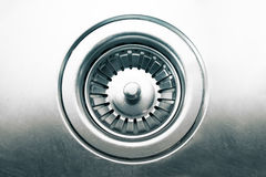 A stainless steel kitchen sink drain Stock Photography