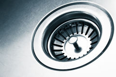 A stainless steel kitchen sink drain. Detail Stock Photo