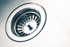 A stainless steel kitchen sink drain Royalty Free Stock Images