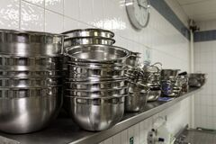 Free Stainless Steel Kitchen Ware In An Industrial Kitchen Stock Photo - 170344470