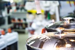 Stainless steel kitchenware set on shelves, shallow depth of field image stock photo