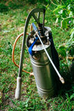 Stainless Steel Knapsack Manual Sprayer for the plants in the farm.  Stock Photo
