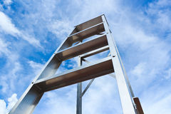 Stainless steel ladder and blue sky Stock Image