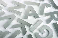 Stainless steel letters. Stylish letters cut out of polished steel Royalty Free Stock Image