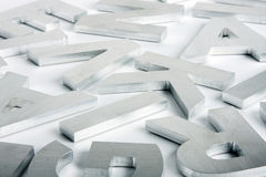 Stainless steel letters. Stylish letters cut out of polished steel Stock Photography