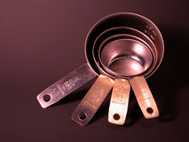 Stainless steel measuring cups Royalty Free Stock Image