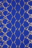 Stainless steel mesh. Macro stainless steel mesh or web web with blue background Stock Photo