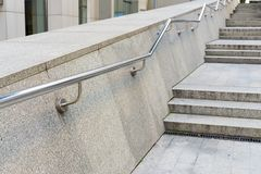 Stainless steel metal handrails. On stone steps royalty free stock photos