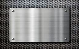 Stainless steel metal plate background. Stainless steel metal plate over perforated background Stock Photos