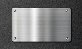 Stainless steel metal plate on black texture Stock Images