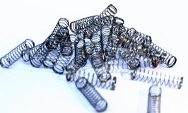 Stainless steel metal springs of ball point pen islolated. This image consists of stainless steel metal springs of ball point pen islolated Stock Images