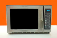 Stainless Steel Microwave. A modern stainless steel microwave Royalty Free Stock Photography