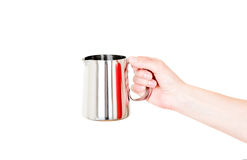 Stainless Steel Milk Boiler Jug in hand isolated on white Royalty Free Stock Photography