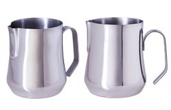 Stainless Steel Milk Pitcher/Jugs. Foaming Jug. Latte art for barista. Coffee Accessories. Barista Kit. Isolated on white background royalty free stock photo