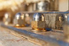 Stainless steel nut as a fastener support soft focus.  royalty free stock photos