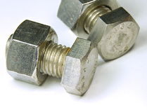 Stainless steel nut and bolt Royalty Free Stock Image