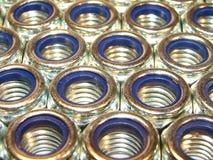 Stainless Steel Nuts. Macro Stainless Steel locking Nuts in Rows Stock Image