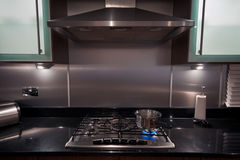 Stainless steel pan on gas hob in a modern kitchen royalty free stock photography