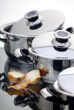 Stainless steel pans. A fragment of a still life of chrome-plated pans stock photography