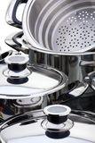 Stainless steel pans. A fragment of a still life of chrome-plated pans stock images