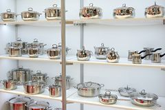 Stainless steel pans for cooking in store. Stainless steel pans for cooking on shelves in the store Stock Image