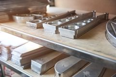 Stainless steel parts on shelf. Royalty Free Stock Photos