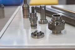 Stainless steel parts. Made from bar by bar feeder and machining process Stock Photography