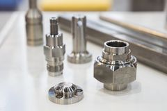 Stainless steel parts. Made from bar by bar feeder and machining process royalty free stock photo