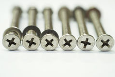 Stainless Steel Philips Head Bolt and Lock Nut Stock Image