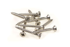 Stainless steel philips screws on a heap Stock Photography