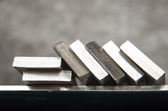 Stainless steel. Pieces of stainless steel on shelf Stock Photography