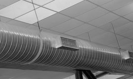 Stainless steel pipe of heating and climatization plant hanging Royalty Free Stock Image