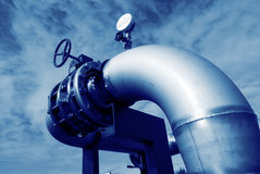 Stainless steel pipelines valves blue sky Royalty Free Stock Images