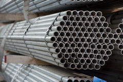 Stainless steel pipes deposited in stacks. Stainless steel construction metal pipes deposited in stacks in a deposit stock images