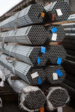 Stainless steel pipes deposited in stacks. In a deposit Stock Photos