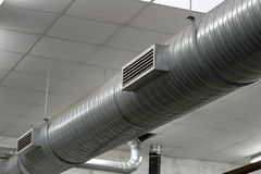 Stainless steel pipes of the heating system. Within an industry location Royalty Free Stock Photography