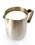 Stainless steel pitcher with milk. Stainless steel pitcher isolated on white Royalty Free Stock Photography