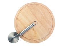 Stainless Steel Pizza Cutter On Chopping Board Royalty Free Stock Image