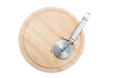 Stainless Steel Pizza Cutter On Chopping Board Royalty Free Stock Images