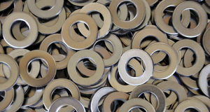 Stainless steel plate. Detailed view of the stainless steel washer Royalty Free Stock Photos