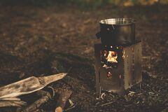 Stainless Steel Pot on Brown Wood Stove Outside during Night Time Stock Photos