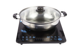 Stainless steel pot on induction cooker Stock Photo