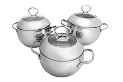 Stainless steel pots and pans (isolated on white) royalty free stock photos