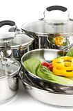 Stainless steel pots and pans with vegetables Stock Photos