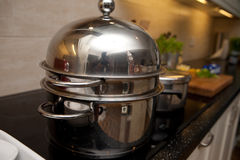 Stainless steel and pots on stove Stock Image