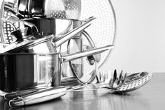 Stainless steel pots and untensils on table. Counter Royalty Free Stock Photo