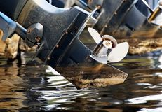 A stainless steel prop on an outboard boat motor. stock image