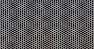 Stainless steel punched metal sheet. Texture of a stainless steel punched metal sheet Stock Image