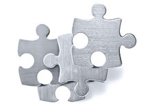 Stainless steel puzzle pieces on white background Stock Photo